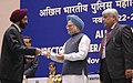 Manmohan Singh gave away the President's Police Medal to Shri Gurbachan Singh, Joint Director, Chandigarh for distinguished services on the occasion of Independence day-2008, at the DGPsIGPs Conference-2008, in New Delhi.jpg