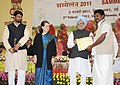 Manmohan Singh presenting award for the best performing Gram Panchayat for the year 2009-10 at the Mahatma Gandhi NREGA Sammelan-2011, on the completion of five years of Mahatma Gandhi NREGA, in New Delhi.jpg