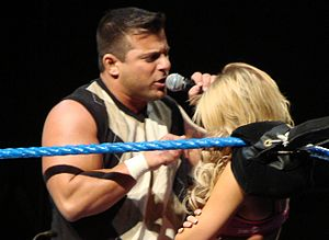 Matt Striker - Striker (left) talking down to Kelly Kelly at an ECW live event