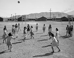 Volleyball - Japanese American women playing volleyball, Manzanar internment camp, California, ca. 1943
