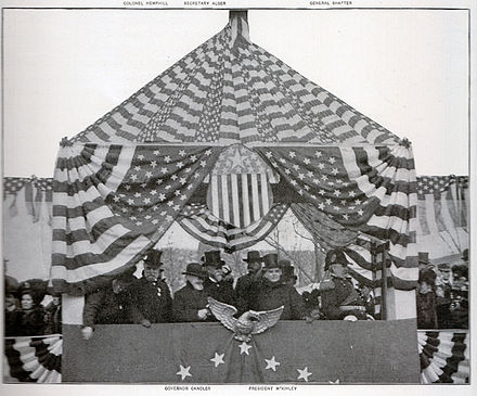 McKinley, (right of center) flanked by Georgia Governor Allen D. Candler (front row to McKinley's right) and Gen. William Rufus Shafter, reviewing the Atlanta Peace Jubilee parade, December 15, 1898. McKinley at Atlanta.jpg