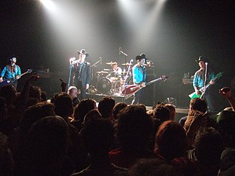 "Me First and the Gimme Gimmes - The core lineup, left to right: Cape, Slawson, Raun, Burkett, and ""Jake Jackson"" (Chris Shiflett)"