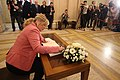 Michelle O'Neill signs the Book of Condolence to Martin McGuinness (33482185392).jpg