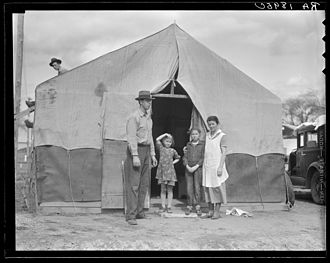 """The Harvest Gypsies - Photo by Dorothea Lange of a migrant family in Kern County. The """"new migrant worker"""" Steinbeck discusses is that who comes with his family. 1936"""