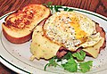 Mmm... egg over easy on ham and cheese (6790201683).jpg