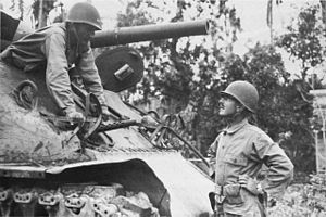 William C. Chase - Major General Verne D. Mudge (in tank) confers with Brigadier General William C. Chase in Tacloban.