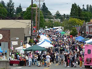 Multnomah, Portland, Oregon - The street fair in Multnomah Village during Multnomah Days 2009. Looking northeast down SW Capitol Highway from its bridge over SW Multnomah Blvd.