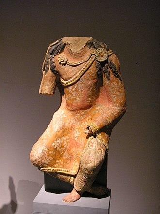 Kumtura Caves - Headless statue from Kumtura at the Museum für Asiatische Kunst, Berlin