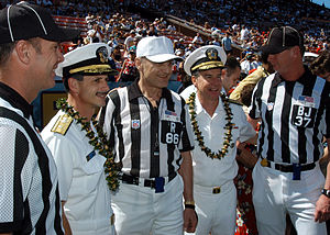 National Football League officials pose with United States Navy officers prior to the 2005 Pro Bowl.