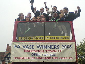Nantwich Town F.C. - The open-top bus on arrival at Nantwich Civic Hall in Market Street. The FA Vase is raised aloft.