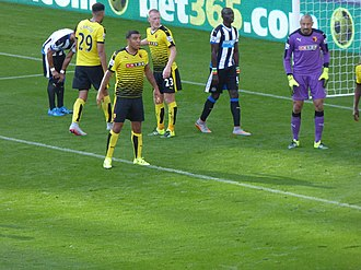 Troy Deeney - Deeney (third from left) playing for Watford in 2015