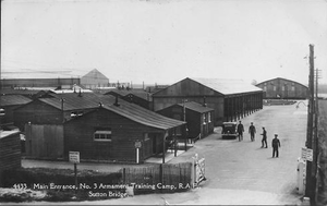 RAF Sutton Bridge - 1930s, No. 3 Armament Training Camp, RAF, Sutton Bridge: Airfield west side embankment main entrance. Visible in the far left background is the new Hinaidi type aircraft hangar built during the 1930s replacing two of the airfield's original four Bessonneau type aircraft hangars.