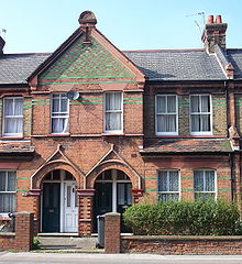 What appear to be normal two-storey terraced houses, but with two doors in each porch instead of one