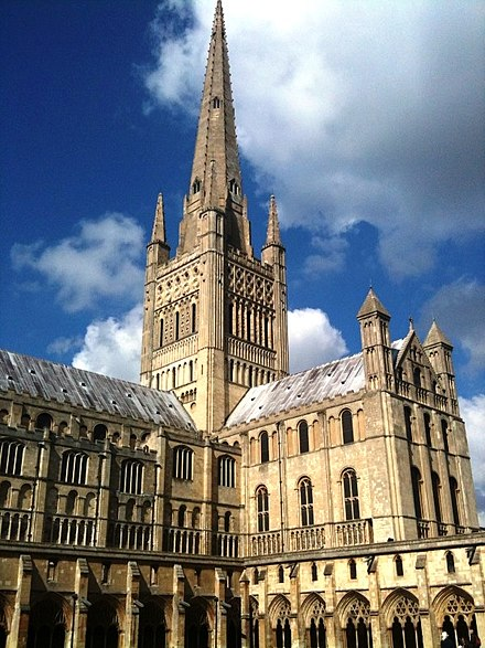Norwich Cathedral is one of the great Norman buildings of England. Norwich Cathedral, spire and south transept.jpg