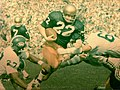 Notre Dame halfback Denny Allan carries the ball against Michigan State (1745285694).jpg