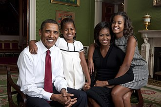 Barack Obama - Obama posing in the Green Room of the White House with wife Michelle and daughters Sasha and Malia, 2009