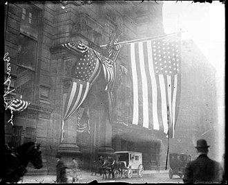 Chicago Board of Trade Building - Entrance with U.S.A. flag and a horse drawn wagon in street, 1909