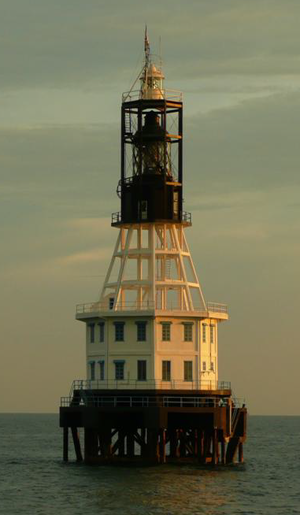 """One Fathom Bank Lighthouse - The present """"old lighthouse"""" is the third iteration of the One Fathom Bank Lighthouse to be built. It was deactivated after the new lighthouse began operation in 1999."""