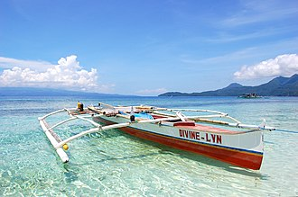 Outrigger canoe - A double outrigger canoe in White Island, Philippines.