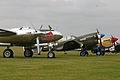P-38 and P-40 line-up at Flying Legends 2011 (6992436563).jpg