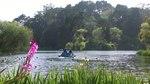 File:Paddle boat on lake.webm