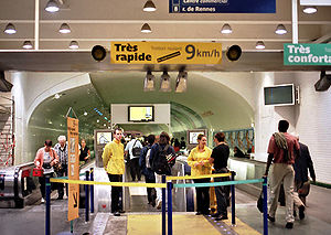 Moving walkway - View of the TRR walkway, with staff in yellow jackets monitoring.