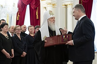 Hero of Ukraine - President Poroshenko handing the medal of Hero of Ukraine and the Order of the State to Filaret.