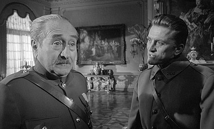 Adolphe Menjou (left) and Kirk Douglas (right) in Paths of Glory (1957) Paths of Glory trailer 2.jpg