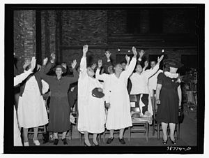 Religion in Black America - Women engaged in praise at a Pentecostal worship service, 1941.