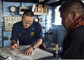 Philippine navy Cmdr. Mario O Argel, right, a safety officer for exercise Balikatan 2013, observes as U.S. Navy Lt. j.g. McKinley Kim plots a course of recovery on the bridge of the amphibious dock landing ship 130409-N-IY633-009.jpg