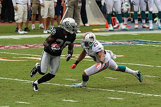 2012 Miami Dolphins season - Miami Dolphins cornerback Jimmy Wilson challenges Raiders running back Phillip Adams, September 16