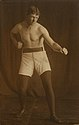 Photographic postcard of a boxer standing with clenched fist (9910359426).jpg