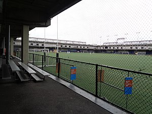 Pier 40 at Hudson River Park - Pier 40's adult baseball field (top), and the walkway and netting circumscribing the field (bottom).