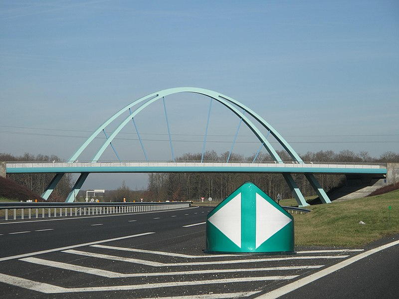The rest area of Villeroy on french highway Autoroute A19, with its crossing bridge, France. Looking to the north.
