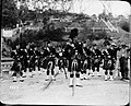 Portrait of a bagpipe band (7443922294).jpg