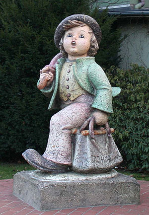 "Hummel figurines - Life-size reproduction of a Hummel figurine, ""Merry Wanderer"", at the entrance of the Goebel company in Rödental, Germany."