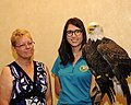 Posing for picture with Bald Eagle. (10596814656).jpg