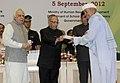 Pranab Mukherjee presenting the National Award for Teacher-2011 to Shri Ashtabhuja Prasad, Uttar Pradesh, on the occasion of the 'Teachers Day'.jpg
