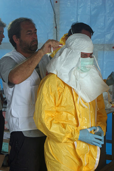 CDC and MSF staff preparing to enter an Ebola treatment unit in Liberia, August 2014 Preparing to enter Ebola treatment unit.jpg