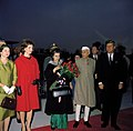 President John F. Kennedy, First Lady Jacqueline Kennedy, Prime Minister of India Jawaharlal Nehru, and Others at Arrival Ceremonies (color).jpg
