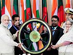 Prime Minister Narendra Modi hands over the steering wheel of INS Vikrant (R11) to Bangladesh PM Sheikh Hasina.jpg