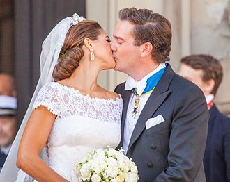 Kiss - Princess Madeleine of Sweden and Christopher O'Neill kiss each other post their wedding, 2013