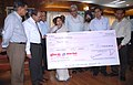 RCIL, a public sector undertaking under the Ministry of Railways presented a cheque of Rs. 15- crore as interim dividend for the year 2009-10 to the Union Minister for Railways, Kumari Mamata Banerjee, in New Delhi.jpg