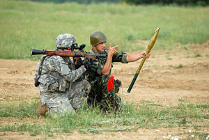 Shoulder-fired missile - An American-Bulgarian team prepares to reload an RPG-7 with a fresh rocket.