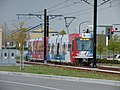 Red Line TRAX train just past Daybreak Parkway station, Apr 16.jpg