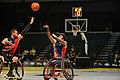 Retired U.S. Marine Corps Sgt. Anthony McDaniel shoots over a U.K. defender in the championship wheelchair basketball game at Invictus Games 2016 (27035187142).jpg