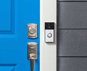 Ring (company) - The Ring video doorbell, mounted next to the front door of a house