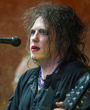 Robert Smith (musician) - Robert Smith playing live with the Cure at Roskilde Festival 2012