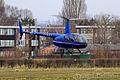 Robinson R44 - G-IAJJ (8657808860).jpg
