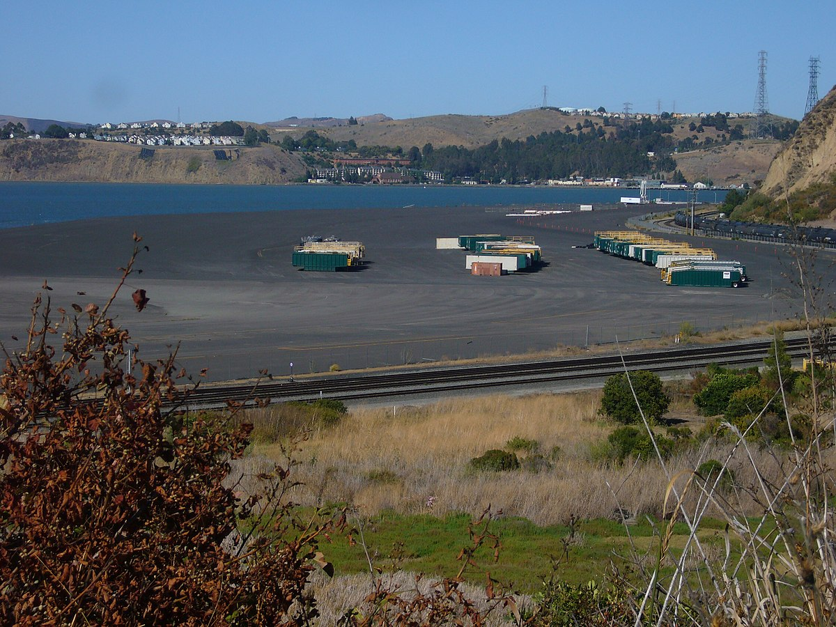 Containers beached on the outskirts of Rodeo with Vallejo and Cal Maritime in the background.